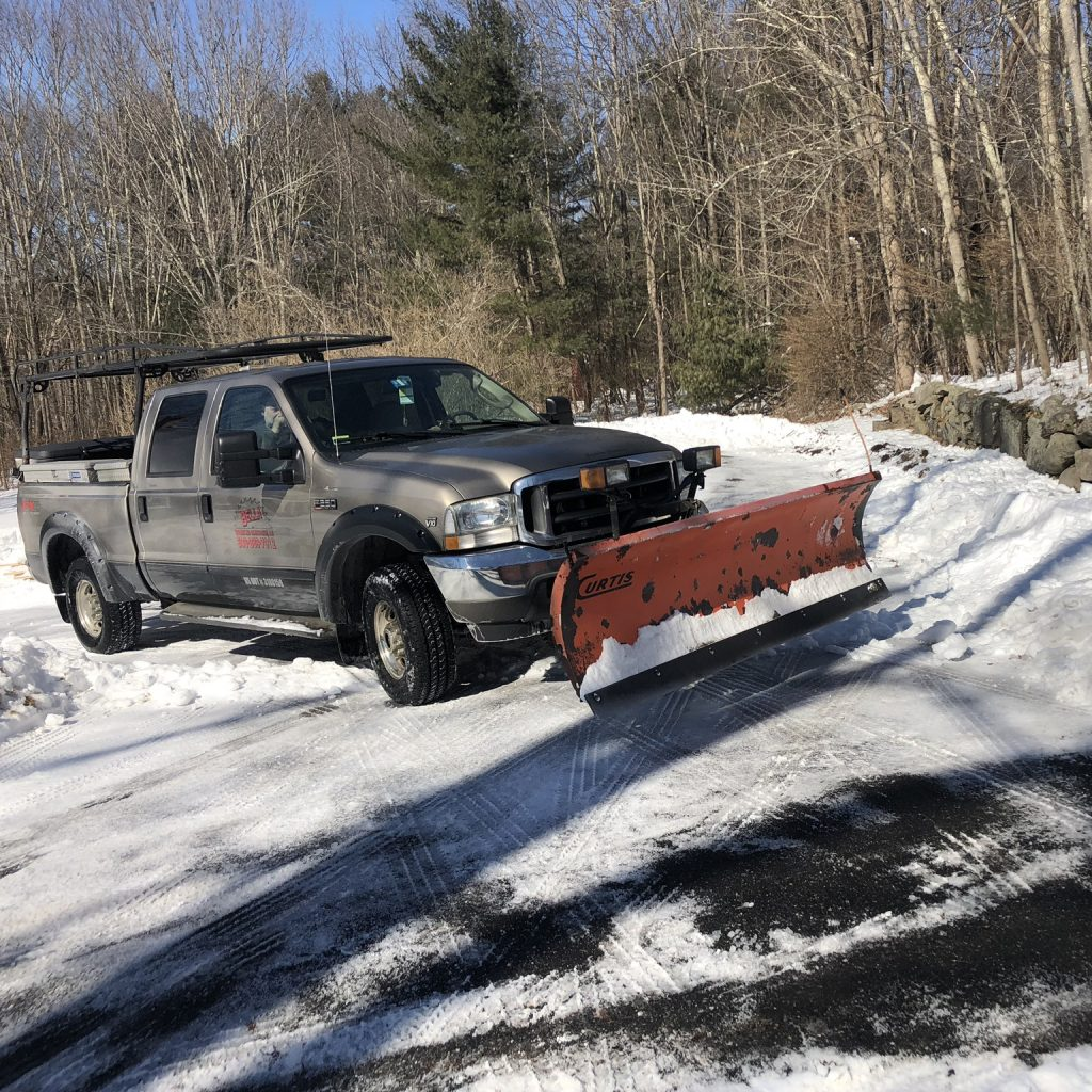 snow plowing truck on road