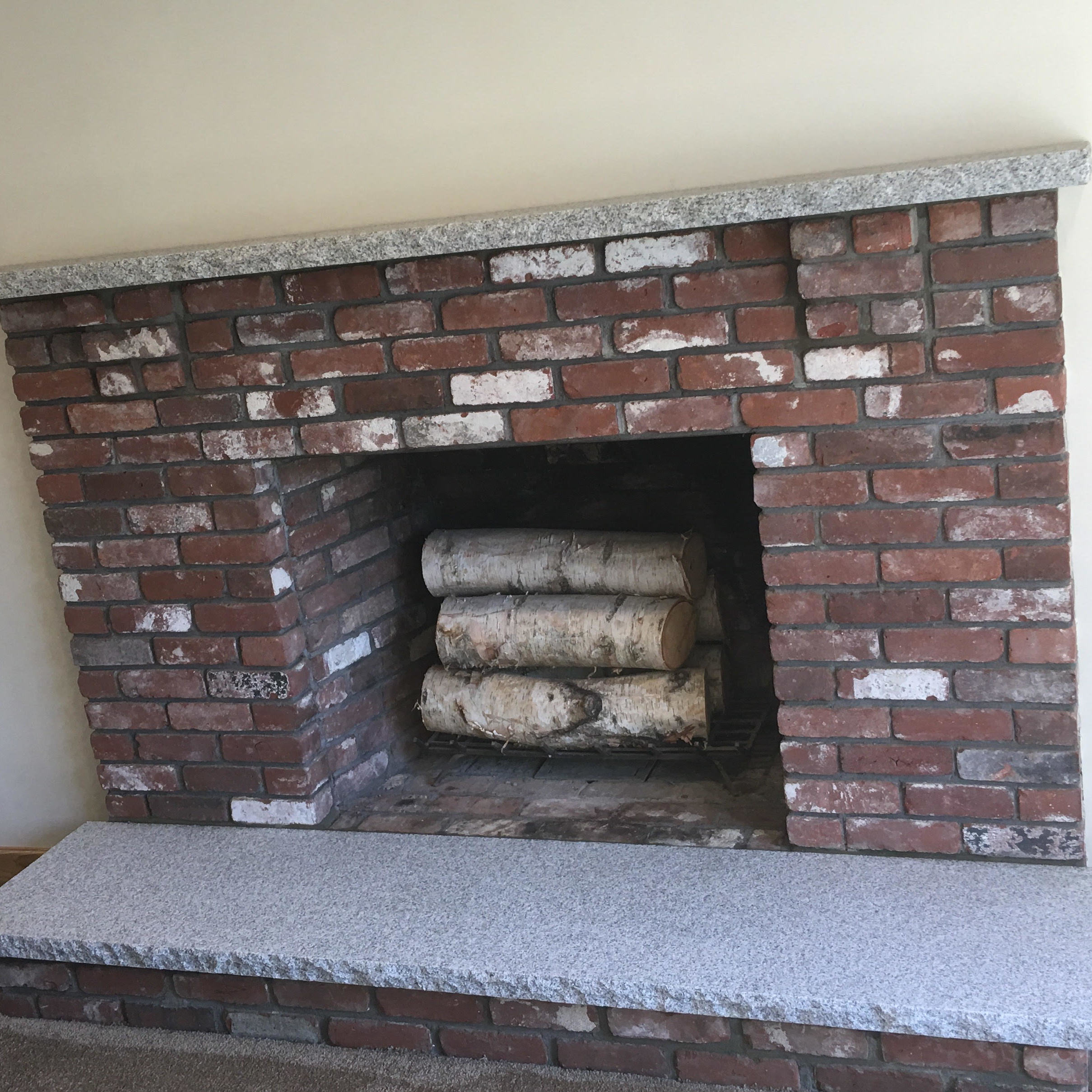 Granite Installed on a Fireplace.